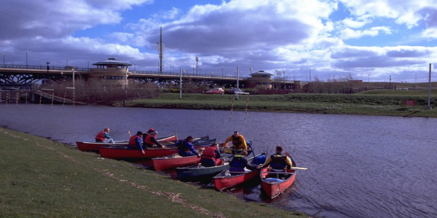 Kayaks on River Tees with Tees Barrage in background