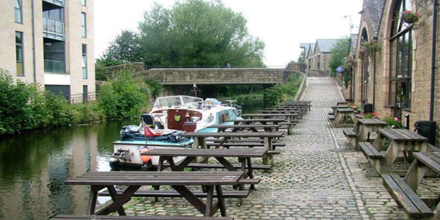 Boat moored outside White Cross Pub on Lancaster Canal