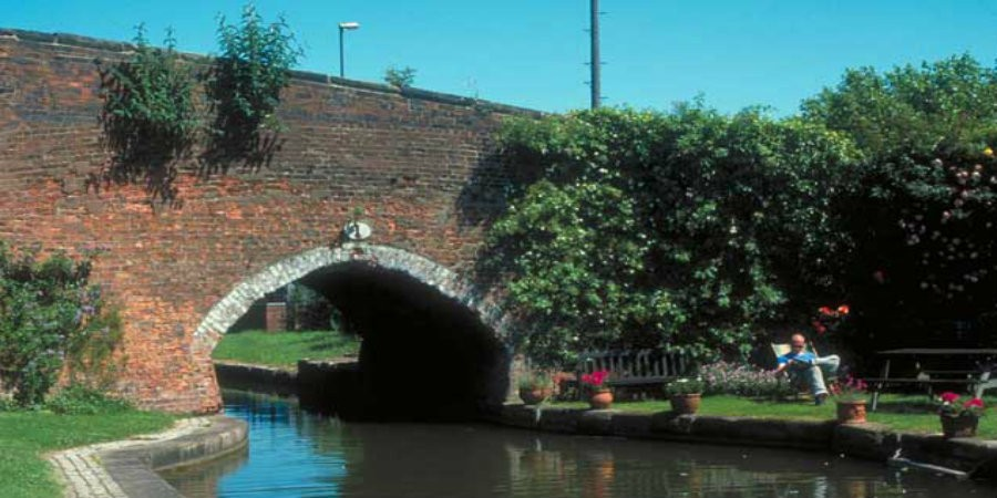 Man sat next to bridge at Coventry Canal Basin