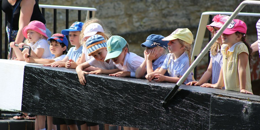 A school trip next to a lock at Stoke Bruerne