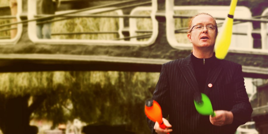 Man juggling by the waterway
