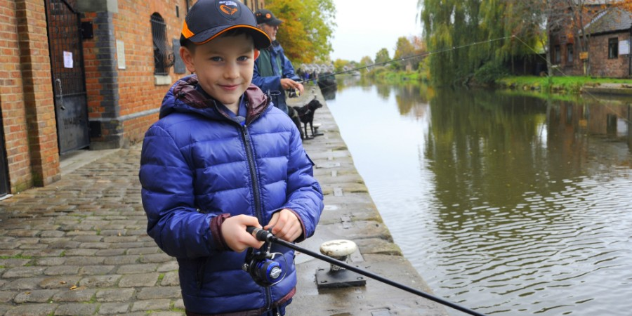 Boy fishing at Camden Lock