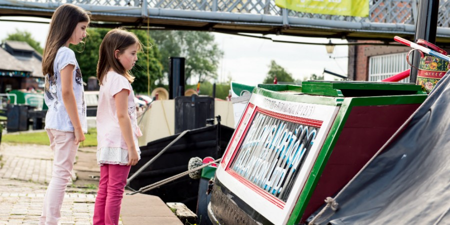 Children looking at boat signage