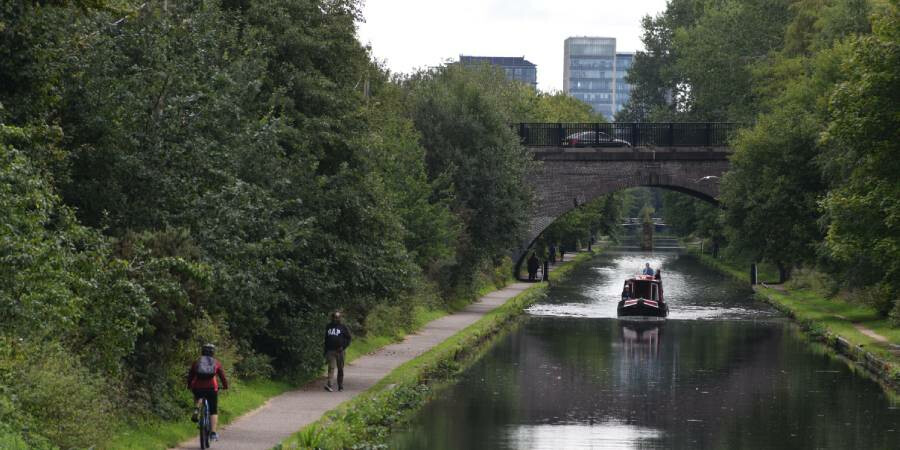 Walkers and cyclists enjoying a towpath walking route in Birmingham