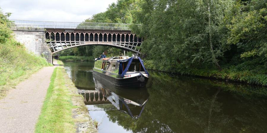 A canal boat passing under a bridge on a Birmingham canal