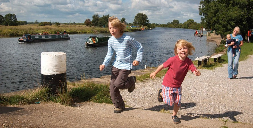 Children running on towpath