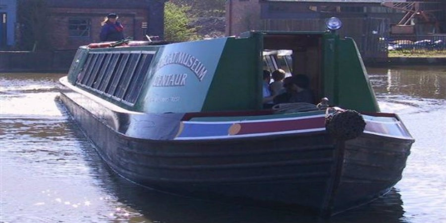 Narrowboat Centaur on water at National Waterways Museum