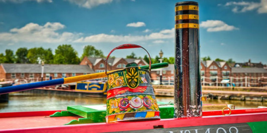 Colourful National Waterways Museum boat with traditional decoration
