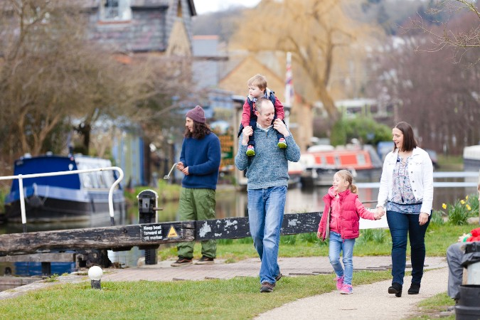 Family walking by the canal