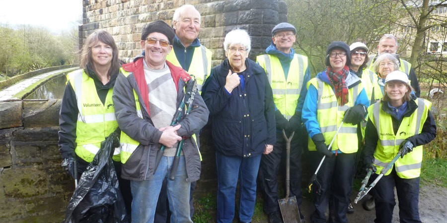 Volunteers by the Huddersfield Narrow Canal