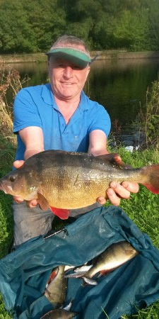 Steve Newns, angler, with perch