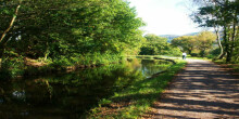 Woman walking dog along towpath at Clydach on Swansea Canal