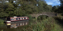 Boat moored in front of bridge on Lancaster Canal