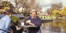 Man enjoying coffee by the canal