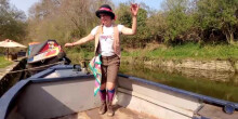 Woman dancing on a boat