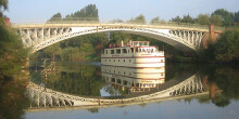 The Edward Elgar, run by English Holiday Cruises, at Holt Fleet Bridge on the River Severn