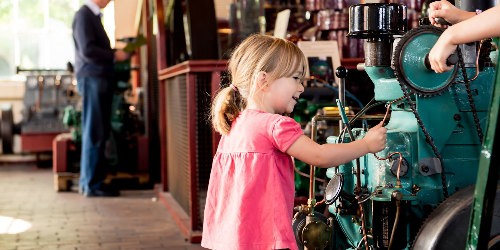 A young girl playing with an engine in the National Waterways Museum
