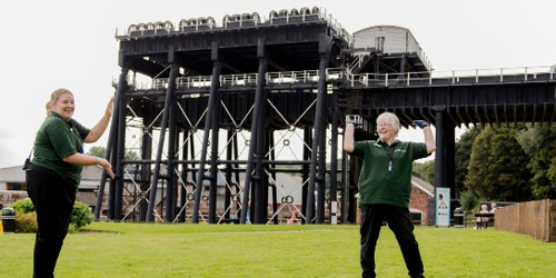 Volunteers in green t-shirts at Anderton Boat Lift