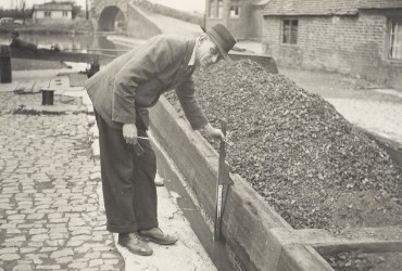 Toll Clerk gauging a coal boat at Hawkesbury Junction 1940's