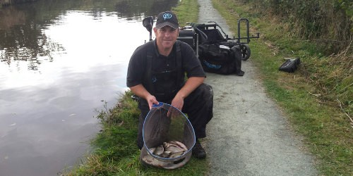 Angler on the Llangollen Canal