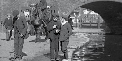 Two boys chatting by the canal