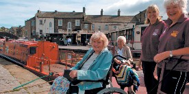 Wheelchair users enjoy the Leeds & Liverpool Canal