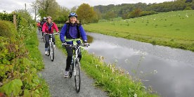A group of cyclists on the Montgomery Canal towpath