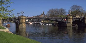Bridge over River Ouse in York with boats moored behind bridge