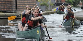 A group of people canoing through the centre of Birmingham