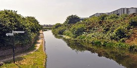 View down Daw End Branch Canal with signpost in foreground