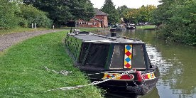 Boats moored along towpath of Welford Arm of Leicester Line
