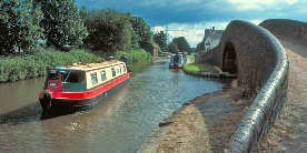 Narrowboats next to bridge on Coventry Canal