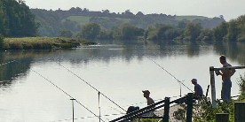 Anglers on banks of River Trent