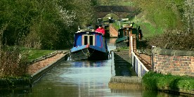 Boat crossing aqueduct on Stratford Canal