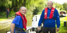 Two volunteer lock keepers stood by a lock