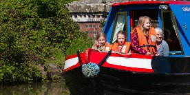 A family taking a boat holiday on the Grand Union Canal