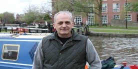 Terry Halliwell, Heritage volunteer, stood on towpath in front of boat