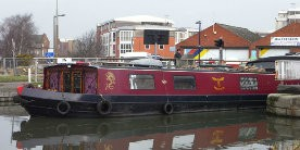 Boat passing by swing bridge, Dewison Road on Selby Canal