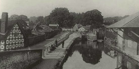 Black and white photo of Montgomery Canal with cottages on towpath