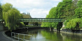 Halfpenny Bridge crossing canal with trees either side