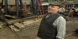 Fred Dibnah stood in mill yard