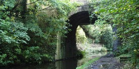 View waterway going through deep cutting under bridge