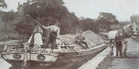 Black and white photo of horse drawn short boat photographed around 1900.