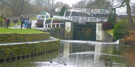 Dowley Gap Two Rise locks with people walking by