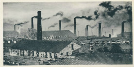 Black and white photo of Burnley Embankment with mills with smoking chimneys