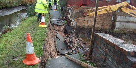 Towpath collapse with cones and digger