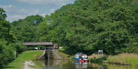 Boat moored near lock on Macclesfield Canal