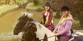 two girls horse riding