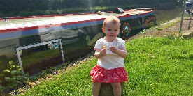 18 month year old Eliza by her family boat
