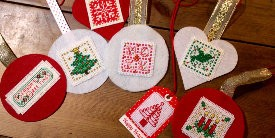 Home made needlework decorations for hanging on a boat